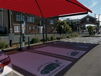 This is a photo of a Shade Systems Cover over two Car Charging Parking Spaces